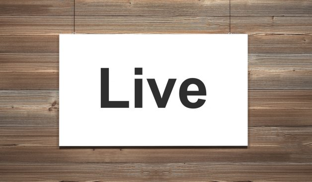 white canvas hanging on wooden wall live